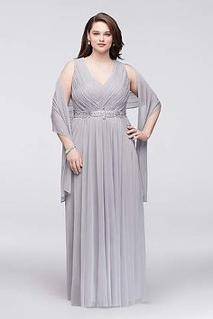 0be3594d450 Pleated and woven chiffon forms the figure-flattering bodice of this plus-size  gown