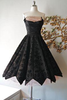 50's pink and black flocked taffeta party dress with zig-zag hem and ruffled shelf bust. Love it!!