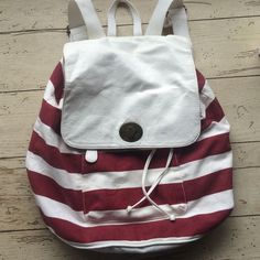 Backpack style striped bag Ted and white striped backpack style bag. Adjustable straps. Front zipper pocket on outside. Inside has two small pockets as well as larger zipper pocket. Drawstring closure. White leather top flap. Some stains inside from use but overall good condition Mossimo Supply Co Bags Backpacks