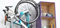 """Creative DIY bike storage racks to solve the """"how to store bikes"""" question! These DIY bike racks are inexpensive to make and are simple projects! Bike Storage Hanging, Vertical Bike Storage, Bike Storage Rack, Shed Storage, Small Storage, Garage Storage, Diy Bike Rack, Bike Hooks, Bike Wall Mount"""