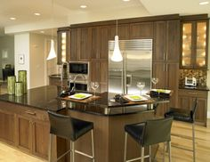Walnut cabinets, dark countertop
