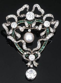 A Belle Époque Diamond, Emerald and Pearl Brooch Pendent. Of openwork design…