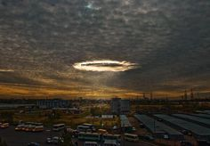 Fallstreak hole/hole punch cloud over Novokosino, Moscow, Russia. / more about fallstreaks: http://en.wikipedia.org/wiki/Fallstreak_hole