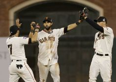 San Francisco Giants outfielders Gregor Blanco (7), Angel Pagan and Hunter Pence, right, celebrate a 2-0 win against the Detroit Tigers in G...