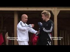 Wing Chun Lesson 48: Block, cover and Elbow to the chest (Pad work)