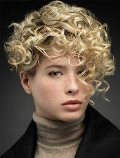 Short curly asymmetrical  bob