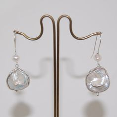Check out this item in my Etsy shop https://www.etsy.com/listing/281800984/dangling-earrings-bridalwear-sterling