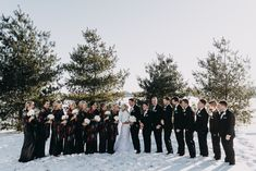 Brittany and Tyler with their wedding party. PC: Brian Coss Photography