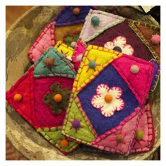 We are always thrilled with the quality and craftsmanship of the items we import from Nepal- they are such a signature of the culture and creative crafters of Nepal.   Each of these tiny bags is carefully handmade and felted, and the quality is so much be