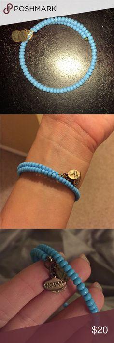 SOLD - Alex and Ani Beaded Wrap Bracelet NWOT Alex and Ani Beaded Wrap Bracelet NWOT. Never worn! Pretty blue color. Beads wrap all the way around. Alex & Ani Jewelry Bracelets