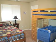 crib and todlle bed in 1 room    Room 2- Full bed, twin bunk and crib (optional)