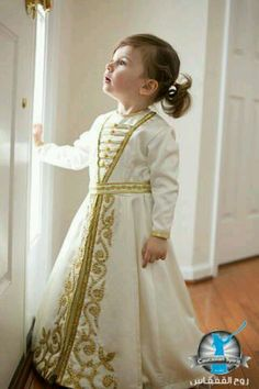 Tiny little Circassian princess in white and gold gown