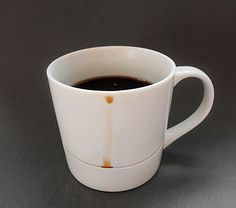 An insanely simple design for a coffee cup that catches all the drips. | 26 Products You Can't Believe Don't Exist Yet