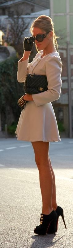 Perfect combination of white coat black leather gloves and handbag with black high heels shoes