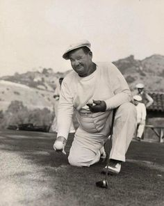 A rare image of Oliver Hardy playing golf.  (aw, I love this - don't get to see many candid shots of them)