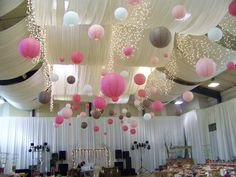Pink hanging lanterns and dove grey wedding lantern look amazing together in any wedding venue! Add fairy lights for added sparkle.