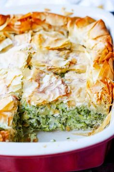Kolokithopita or Greek Zucchini Pie is a perfect comfort food for the end of the Summer The dish is a simple combination of zucchini onions herbs eggs feta wrapped in a. Pie Recipes, Cooking Recipes, Healthy Recipes, Greek Food Recipes, Phyllo Dough Recipes, Punch Recipes, Cheese Recipes, Shrimp Recipes, Gourmet Recipes