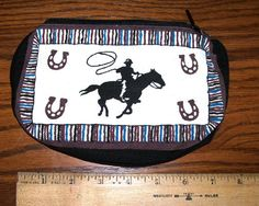 a cute little 5x7 western Steer Roper tote bag that zips close.  Great for keeping makeup and such organized.  Just 7.95 w/ free shipping! #totebag #makupbag #western #cowgirl