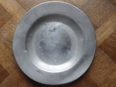 Vintage French medium Pewter Etain dish tray charger platter plate serving table display old aged used circa 1950-60's Purchase in store here http://www.europeanvintageemporium.com/product/vintage-french-medium-pewter-etain-dish-tray-charger-platter-plate-serving-table-display-old-aged-used-circa-1950-60s/