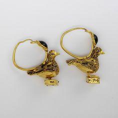 Ancient Greek earrings featuring Aphrodite's dove. (Victoria & Albert Museum)
