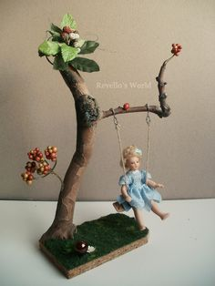 https://flic.kr/p/JLU32d | Fairy swing | Handmade fairy swing in 1:12 scale out of tree branches decorated with flowers and leaves. Available here: www.revellosworld.de/produkt/feenschaukel/