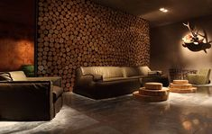 rustic wood on walls | rustic living room with Leather upholstered sofa and wood wall