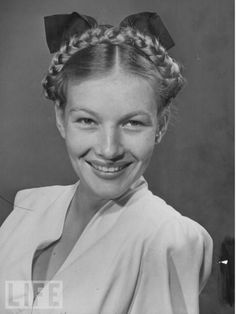 a rare photo of the lovely veronica lake ;hair braided and smiling. she looks radiant.