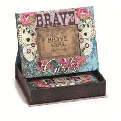 This unique #gift set comes with a picture #frame box and #photo album, each slathered in gorgeous art. The top of the box doubles as a picture frame and can be displayed when open by setting the edges in the convenient slots. Frame reads Brave Girls and features butterfly wings, big pink roses, and tons of textural contrast. The included photo album is bound with a leather bow and reads Brave girls change the world with their wings. It also has gorgeous butterfly wings and plump pink roses…