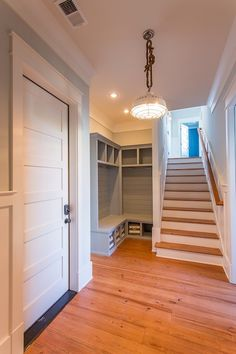Lockers, board and batten, grey color and wainscotting up the stairs