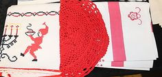 Christmas theme: embroidered dish towel and crocheted center piece. Floral tablecloth.