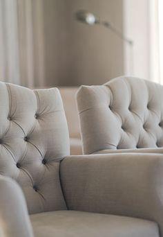 Beautiful plain linen button back armchairs