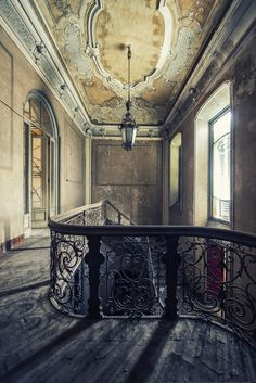 explore some beautiful old building....i can almost picture us standing by that railing