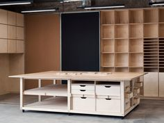 How wonderful would walls full of cubbies be? A second work table could have my rolling twin bed under it.