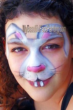 Easter bunny face paint. Tag white and grey split. Pink is Starblend powder. DFX white for details.