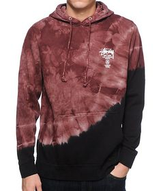 Update your street style with a unique red and black color blocked tie dye fleece lined design and a Stussy world tour cities text graphic on the left chest and back.