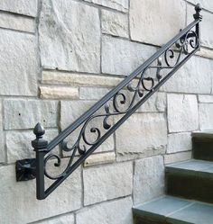 MICRO TREND // 12 Wrought Iron Products That Add Old-World Style To Your Home. Wall Mount Railing: This hand rail is a definite statement piece against a stone wall and stairs. Wrought Iron Stair Railing, Wrought Iron Decor, Staircase Railings, Wrought Iron Gates, Balcony Railing, Banisters, Wrought Iron Designs, Staircases, Iron Handrails