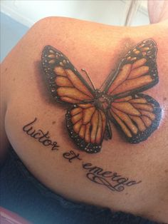 "My new monarch butterfly tattoo. ""luctor et emergo"" (struggle and emerge) with a butterfly to represent my grandfather who raised me. We always had monarch butterflies at his house. When I see one it always makes me think of him. I have been through a lot the past few months and I think this represents everything perfectly. Tattoo done by Daniel Williams of Diamond Thieves in Marion, NC"