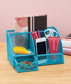 Arrangeyour office supplies in bright style with a mesh organizer. It can hold your smartphone or MP3 player, too. There are6open compartments