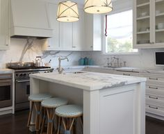 Honed marble, white cabinetry