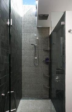 Modern bathroom design black gray tiles corner caddy organizer shower accessories