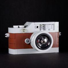 lego camera - Chris McVeigh has designed a LEGO camera replica of the extremely expensive Leica Hermes edition camera. The lovely LEGO version. Lego Camera, Mini Camera, Camera Gear, Photo Lego, Van Lego, Lego Kits, Retro, Foto Fun, Retro Vintage