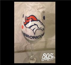 BRONCOS themed decorated wine glass | 805DesignCo - Housewares on ArtFire #DecoratedWineGlasses #Broncos