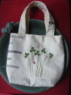 handmade carrier bag with clover embroidery