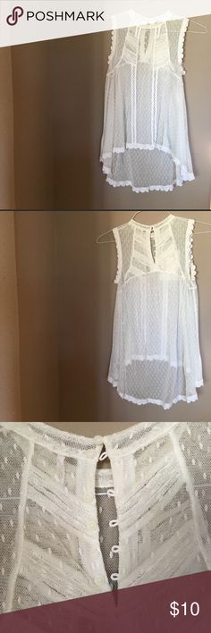 Free People Lace xs Free People White Lace tunic in size xs. Has a few spots here and there but when worn can't tell. Can fit small. Tops Tunics