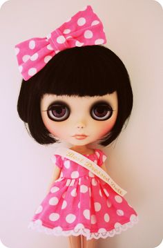 I had a Blythe doll when I was a kid.  You pulled a string or something on the back and the eyes rolled over to a new color.