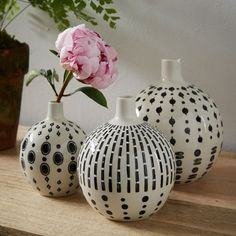Mother's Day gift idea: This trio of black and white bud vases is a result of our collaboration with Potter's Workshop, a collective of South African artists known for their signature bead-like patterns. To bring their unique process to the product, we worked with artisans in China to hand paint each piece.