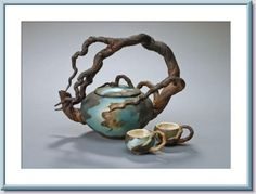 Branches handle tea pot