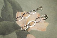 Length: 2 3/4 inches Silver Plated Clip on Earwires Pierced earwires available upon request