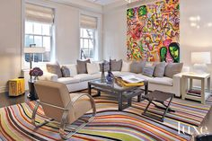 This swirl rug riffs off the exuberant palette in Kenny Scharf's Division of the Sexes while the modern sectional and lounge chair keep things calm.