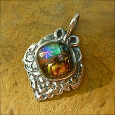 Precious Metal Clay with dichro glass pendant by tasavalon on Etsy https://www.etsy.com/listing/159775453/precious-metal-clay-with-dichro-glass